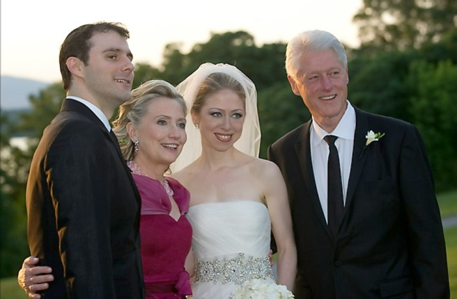 Marc Mezvinsky, Hillary Clinton, Chelsea Clinton, Bill Clinton pose as a family in this wedding picture.