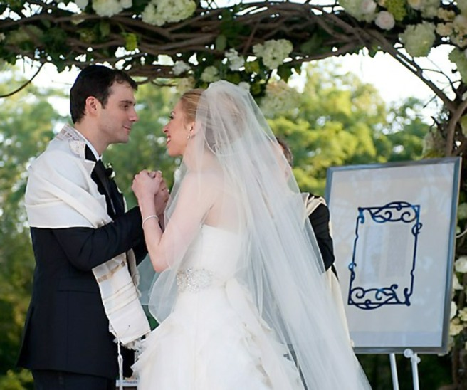 Chelsea Clinton wedding dress holds hands with Marc
