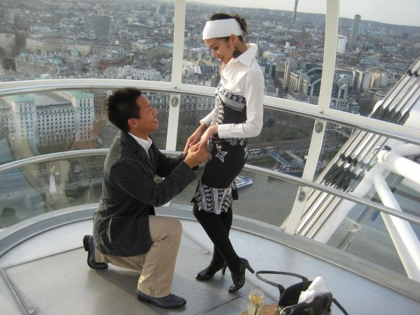 Cute and creative marriage proposal on top of a tower