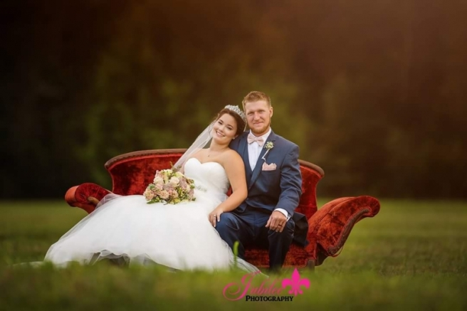bride groom red velvet couch