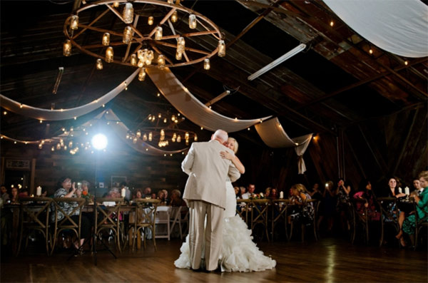A father daughter dance at a premiere barn wedding venue